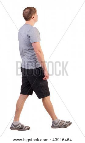 Back view walking handsome man. Sports-dressed young man moves. going young guy. Rear view people collection. backside view person. Isolated over white background. sportsman in summer clothes are left