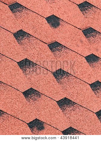 Abstract red tiled rood with textured effect.