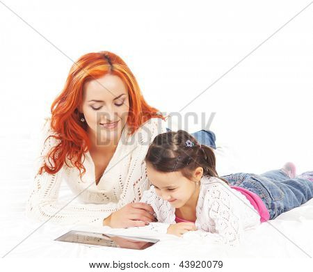 Mother and daughter with the tablet pc isolated on white background