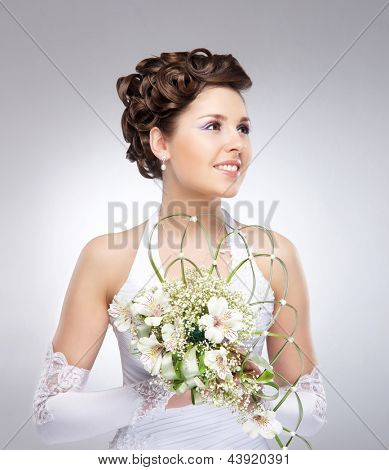 Young, beautiful and emotional bride with a beautiful flowers
