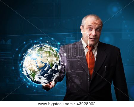 Businessman standing and touching high-tech 3d earth panel elements of this image furnished by NASA