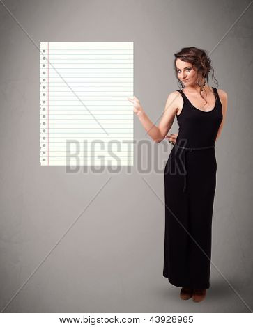 Pretty young lady holding white paper copy space with diagonal lines