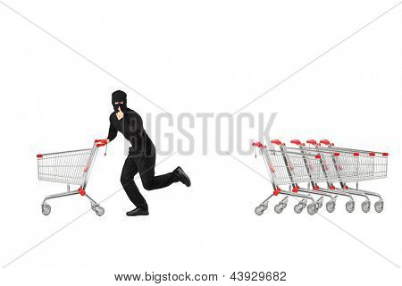 Full length portrait of a robber stealing an empty pushcart, isolated on white background