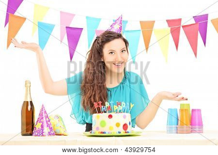 A smiling birthday female with a party hat posing isolated on white background