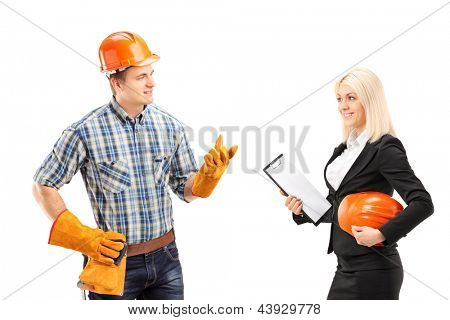 Male manual worker having a conversation with female architect, isolated on white background