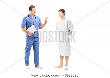 Full length portrait of a male patient in a hospital gown and medical practitioner during a discussion isolated on white background