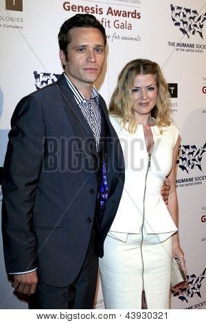 LOS ANGELES - MAR 23:  Seamus Dever, Juliana Dever arrives at the 2013 Genesis Awards Benefit Gala at the Beverly Hilton Hotel on March 23, 2013 in Beverly Hills, CA