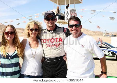LOS ANGELES - MAR 23:  Tyler Clary and family with the Scion FR-S at the 37th Annual Toyota Pro/Celebrity Race training at the Willow Springs International Speedway on March 23, 2013 in Rosamond, CA