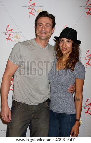LOS ANGELES - MAR 26:  Daniel Goddard, Christel Khalil attends the 40th Anniversary of the Young and the Restless Celebration at the CBS Television City on March 26, 2013 in Los Angeles, CA