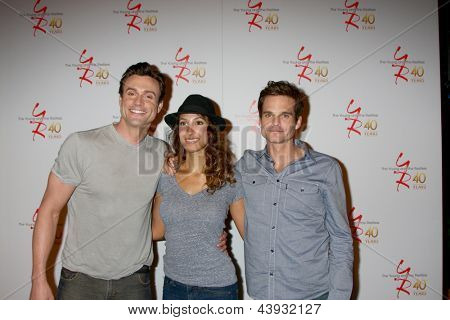 LOS ANGELES - MAR 26:  Daniel Goddard, Christel Khalil, Greg Rikaart attends the 40th Anniversary of the Young and the Restless at CBS Television City on March 26, 2013 in Los Angeles, CA