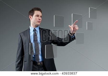 Businessman pushing button. Young man touching screen interface. Pressing technology. Future push interface collection.