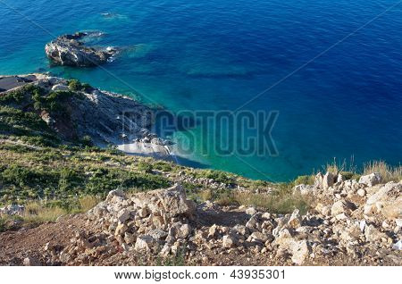 cliff on the blue sea of Jale Beach, Albania