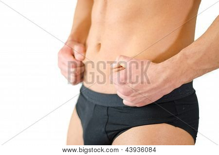 Fit Young Man Pinching His Belly Skin