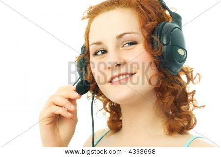 Happy Girl Wearing Earphones With A Microphone