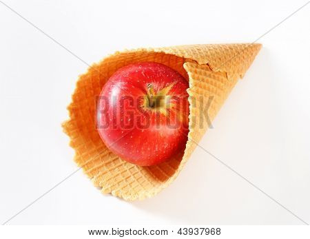 wafer cone with red apple inside