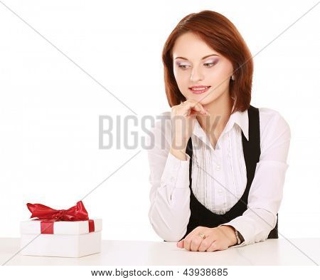 happy smile business woman white gift box with red bow sitting at the desk, isolated over white background