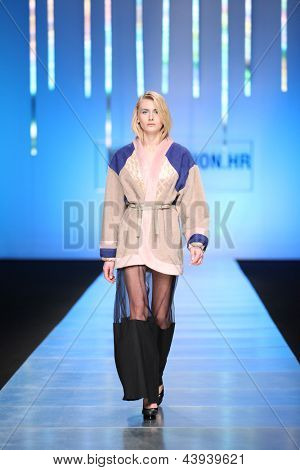 ZAGREB, CROATIA - MARCH 15: Fashion model on catwalk wearing clothes designed by Zona45 Young Sqaut on the 'Fashion.hr' show on March 15, 2013 in Zagreb, Croatia.