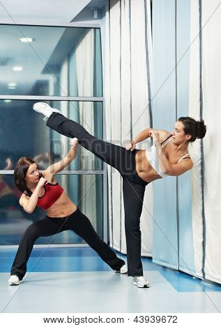 group of woman in gym at fitness physical martial art fighting training exercise in sport wear