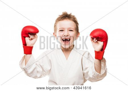 Martial art sport - smiling karate champion child boy gesturing for victory triumph