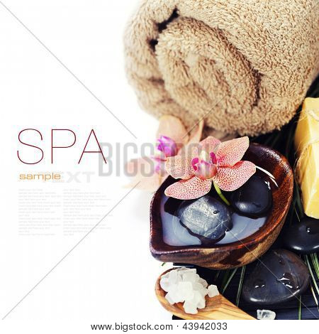 spa concept (zen stones, sea salt, soap, orchid flower and towel) over white  (with easy removable sample text)
