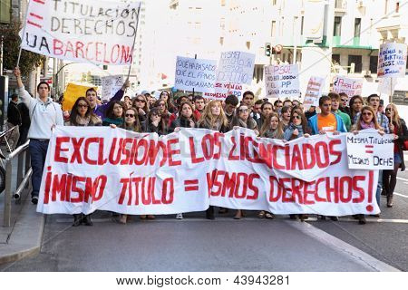 MADRID - MARCH 10: Students take part in demonstration, March 10 2012, Madrid, Spain. Students held in Madrid protesting against cuts in education within austerity policies adopted by the government.