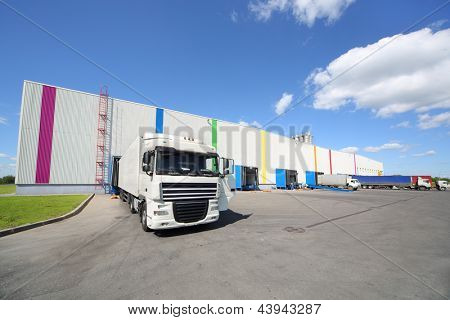 MOSCOW - JUNE 5: Trucks stand near warehouse of Caparol factory on June 5, 2012 in Moscow, Russia. Caparol company has 10 branches in Russia.
