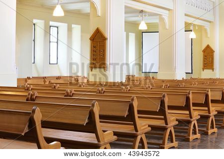 MOSCOW - APR 11: Row of wooden benches in Evangelical Lutheran Cathedral of Sts. Peter and Paul, Apr 11 2012 Moscow Russia. In Evangelical Lutheran Cathedral of Sts. Peter and Paul is altar Bible 1665