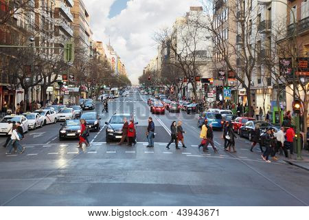 MADRID - MAR 11: People, cars go at street, Mar 11, 2012, Madrid, Spain. Youth unemployment in Spain has exceeded 43% and government proposed new incentives for employers, who will take youth to work.