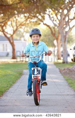 Boy Wearing Safety Helmet Riding Bike