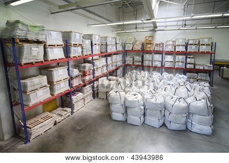 MOSCOW - JUNE 5: Small warehouse with lot of big white sacks  in Caparol factory on June 5, 2012 in Moscow, Russia. Founders Caparol, Ernst Muryan and his son Edward, formed company in 1885.