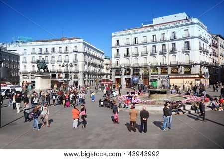 MADRID - MAR 11: People at Puerta del Sol near monument to Carlos III, Mar 11, 2012, Madrid, Spain. Youth unemployment in Spain has exceeded 43% and government proposed new incentives for employers