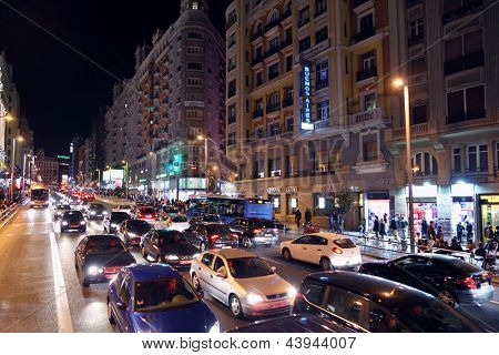 MADRID - MARCH 10: Cars and people at Gran Via street at night on March 10, 2012 in Madrid, Spain. Gran Via unofficially considered main street of capital of Spain.