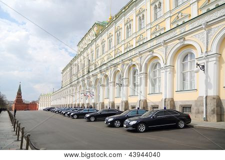 MOSCOW - APRIL 24: Government cars with lights flashing are near Grand Kremlin Palace on April 24, 2012 in Moscow, Russia. Great Kremlin - is ceremonial residence of President of Russia