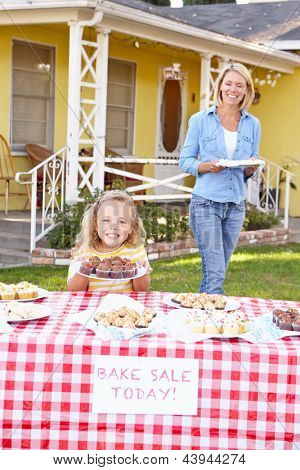 Mother And Daughter Running Charity Bake Sale
