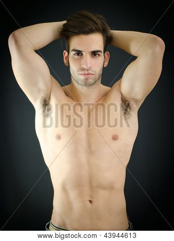 Sexy Young Man, Shirtless, With Arms Up Behind His Head