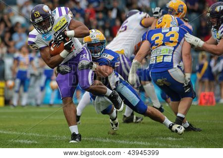 VIENNA, AUSTRIA - JUNE 2: RB Kenneth Chinaemelu (#35 Vikings) is tackled by LB Alex Gross (#37 Giants) on JUNE 2, 2012 in Graz, Austria.