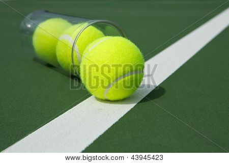 Tennis Balls from a Canister near the court line