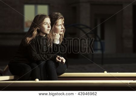 Young girls sitting on the playground