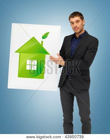 homem bonito, com ilustração de casa eco verde
