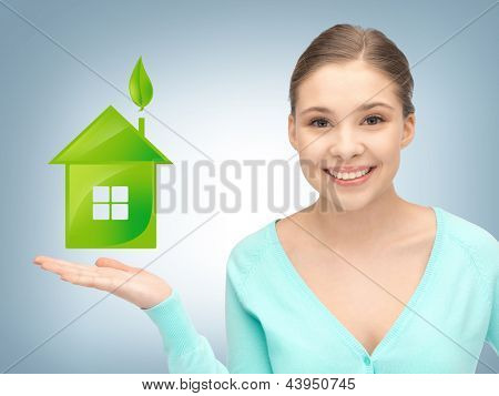 beautiful woman showing light bulb on the palm of her hands