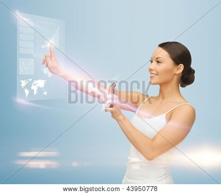 woman holding smartphone and working with virtual screen