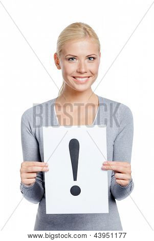 Woman in grey sweater keeps paper with exclamation mark, isolated on white