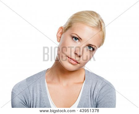 Portrait of tired girl wearing gray pullover, isolated on white