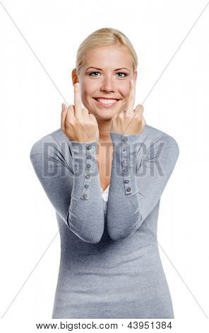 Girl in gray pullover showing obscene gesture, isolated on white