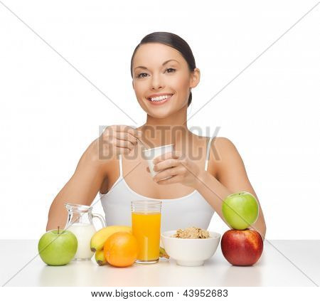 picture of young woman eating healthy breakfast