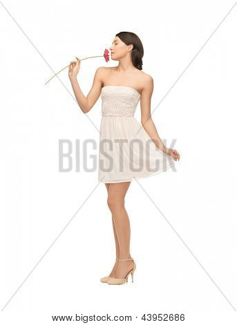 picture of young and beautiful woman smelling flower