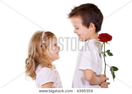 Boy Giving Rose To A Little Girl
