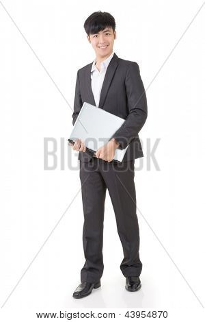 Asian businessman hold a laptop, full length portrait isolated on white background.