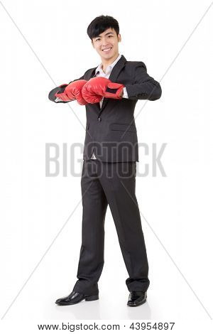 Asian businessman with boxing gloves, full length portrait isolated on white background. Concept about fight, struggle, against etc.