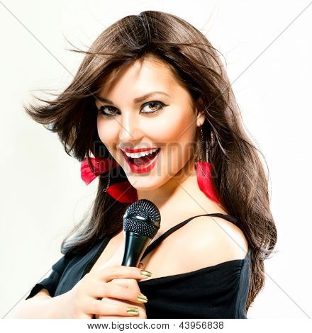 Beautiful Singing Girl. Beauty Woman with Microphone over White Background. Singer. Karaoke.